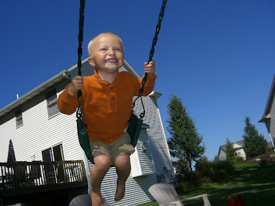 Jack Douglas Ostreko, on the swing set
