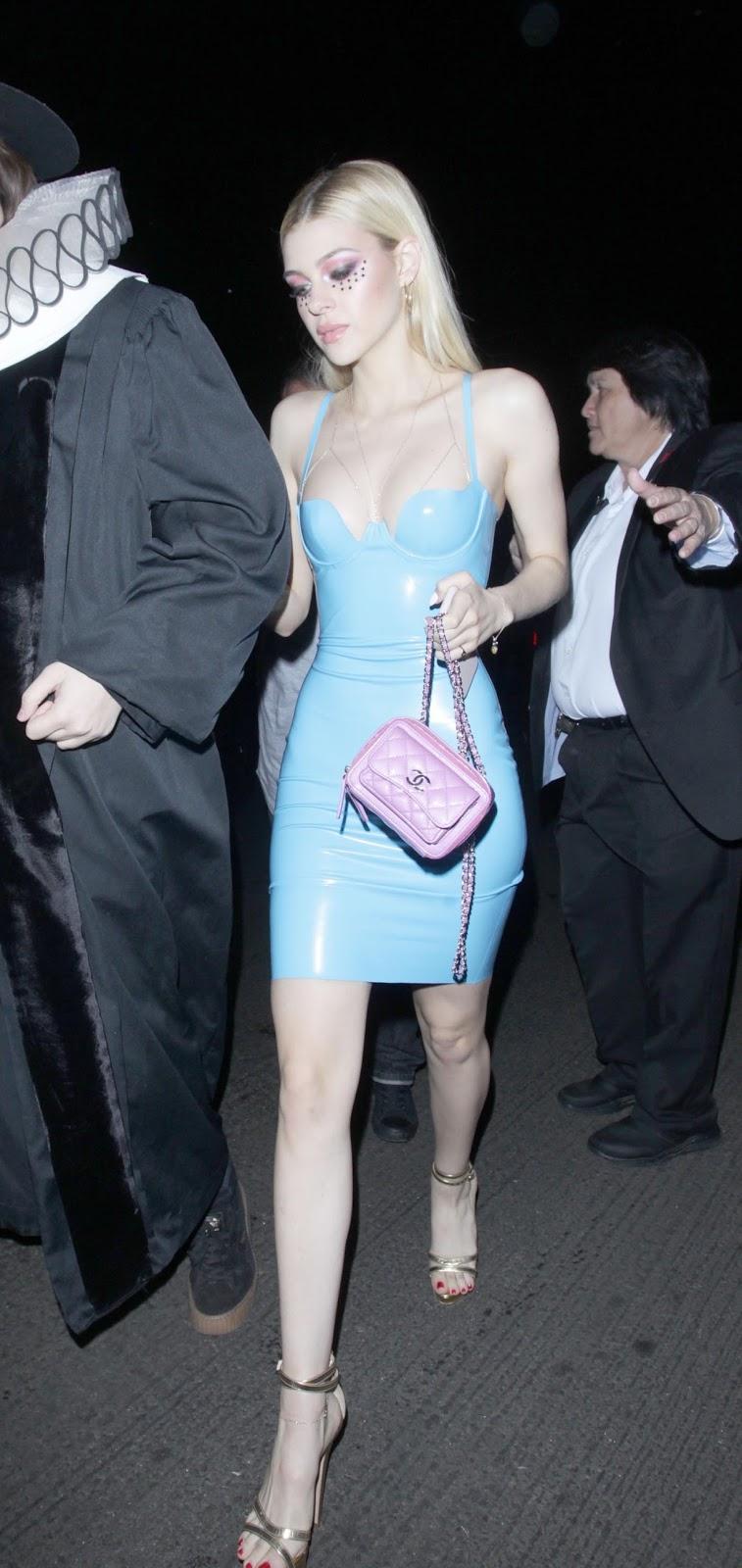 Lovely Ladies in Leather: Nicola Peltz in a latex mini-dress