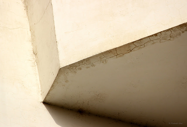 A Minimalist Photo of Lines in a Lookup shot of a Corner of a building,