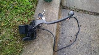 Madura master cylinder assembly lying in the grass