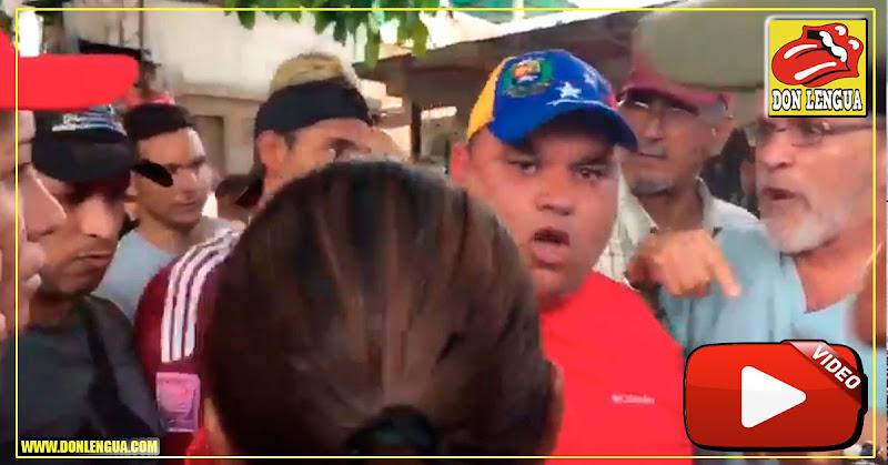 Marginal rojo rojito quería golpear a hombre que repartía Ayuda Humanitaria en Vargas