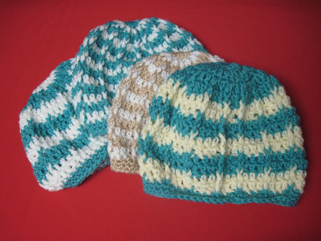 Aunt Ida crocheted hats for OCC shoeboxes.