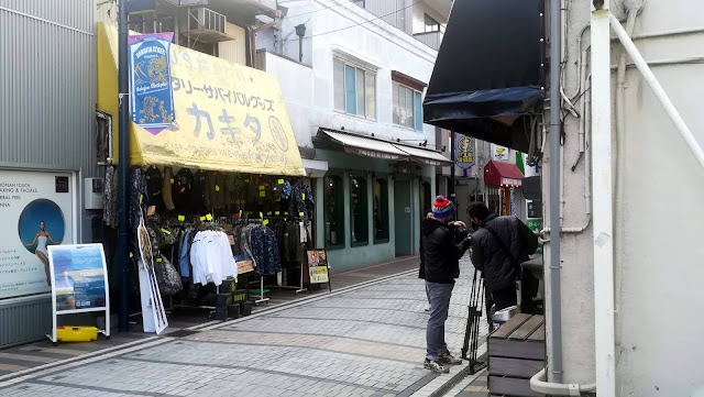 Filming outside the military surplus shop Kakita