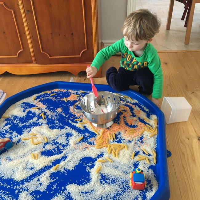 10-five-minute-games-for-toddlers-image-of-toddler-playing-not-so-messy-play-rice-and-lentils-in-a-tuff-tray