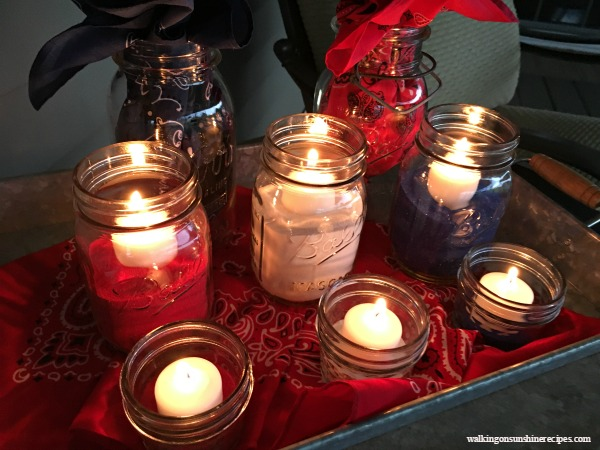 Mason Jar Patriotic Table Centerpiece with mason jars, colored sand and candles.