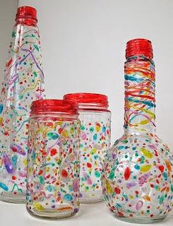 http://manualidadesreciclables.com/14922/botellas-con-velas-de-colores