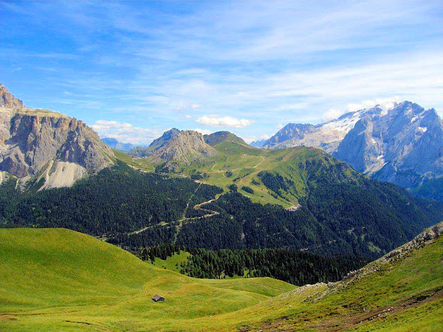 Hikers revel in the staggering views of the Dolomites Mountains at every turn of the trail! Welcome to Canazei as seen from atop Col Rodella in Val di Fassa.