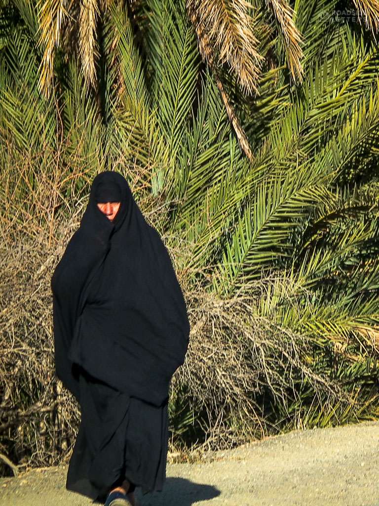 Woman in burka in the desert of Morocco