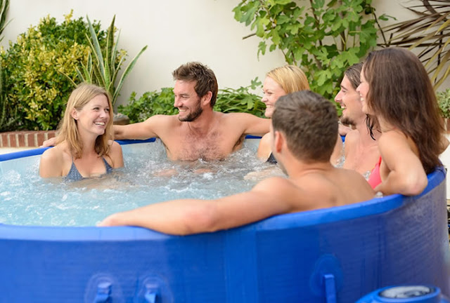 people relaxing in a hot tub