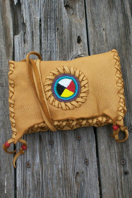 https://www.etsy.com/thunderrose/listing/115579381/beaded-leather-clutch-four-directions?ref=shop_home_active_11