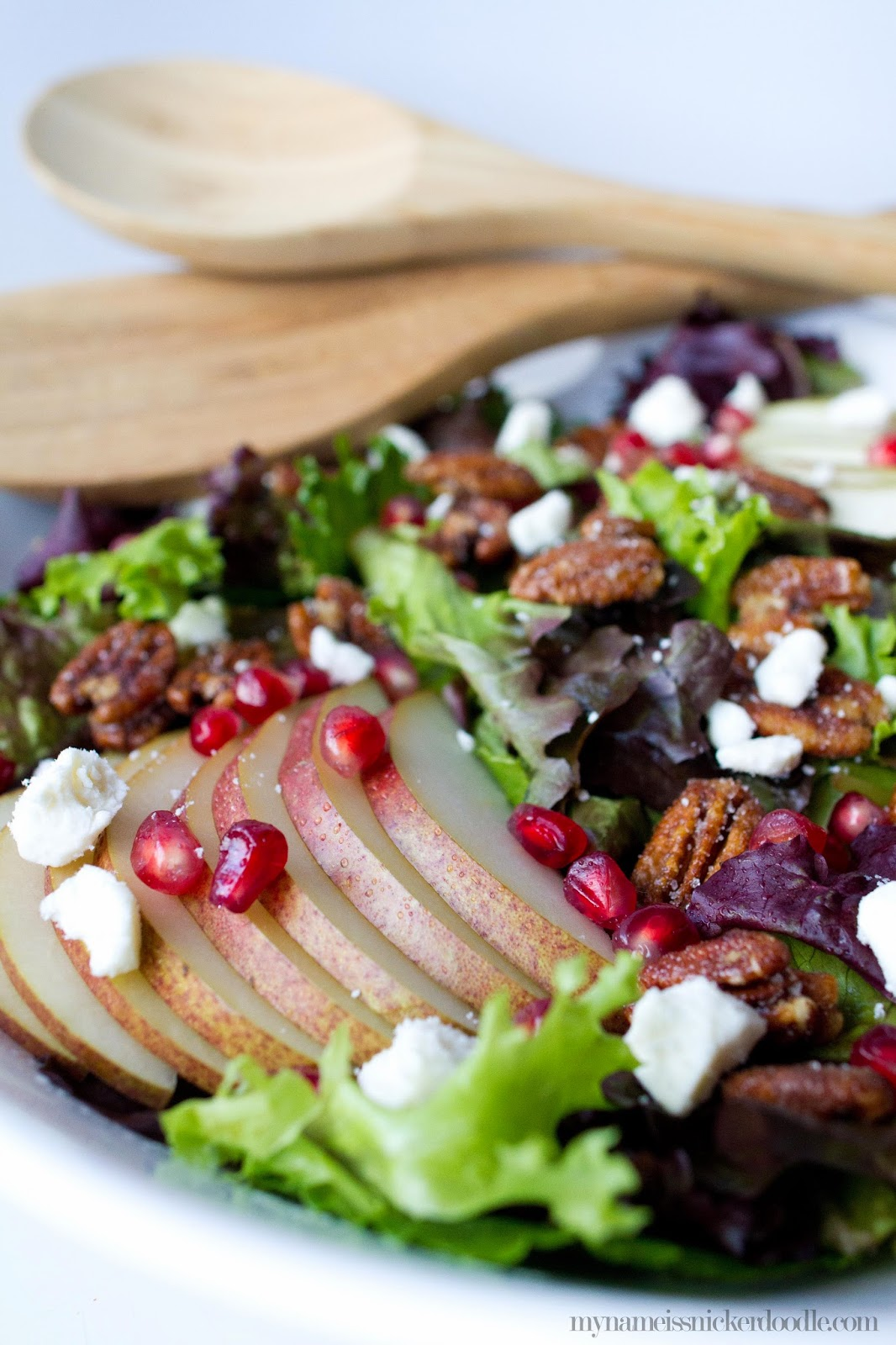 Sweet & Spicy Pecan and Pear Salad... complete with pomegranate seeds and feta cheese. The PERFECT healthy but filling salad to get you back into shape this new year!