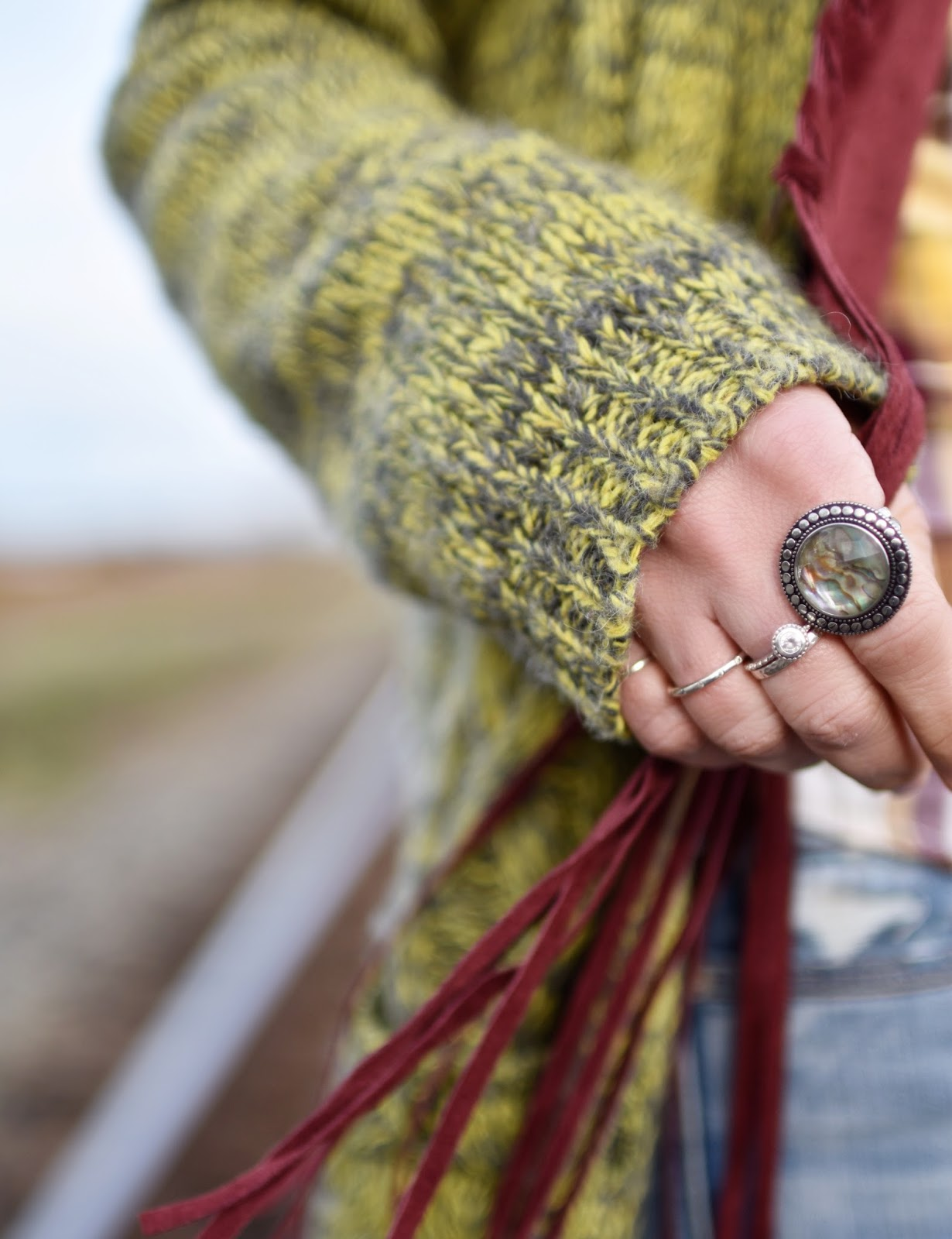 Monika Faulkner outfit inspiration - fringy vest, chartreuse marled cardigan, statement ring