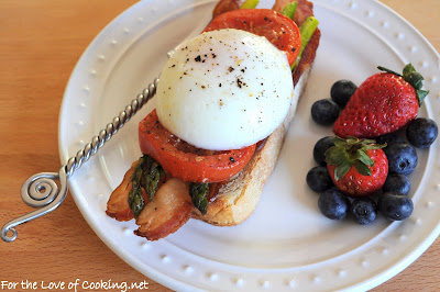 Poached Eggs on Roasted Garlic French Bread with Bacon, Asparagus, and Tomatoes