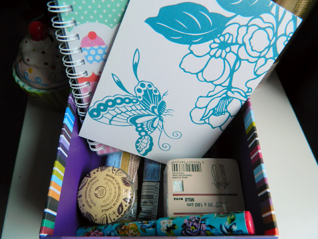 gift box with notebooks, lip balm pen scarf and hot chocolate