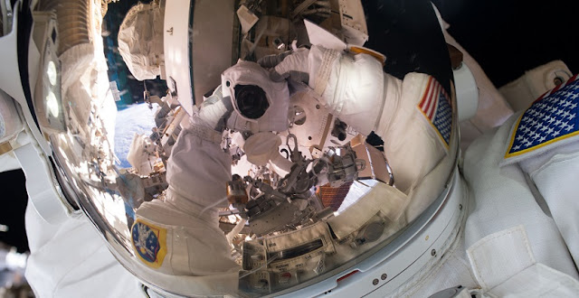 "Expedition 45 Commander Scott Kelly took this photograph during a spacewalk on Oct. 28, 2015. Sharing the image on social media, Kelly wrote, ""#SpaceWalkSelfie Back on the grid! Great first spacewalk yesterday. Now on to the next one next week. #YearInSpace"". Credit: NASA"
