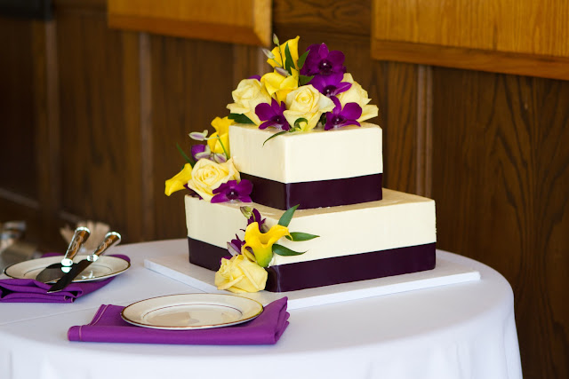 Square Two-Tier Wedding Cake by JCakes with Flowers by Lane & Lenge - Photo Courtesy of Brian Samuels Photography