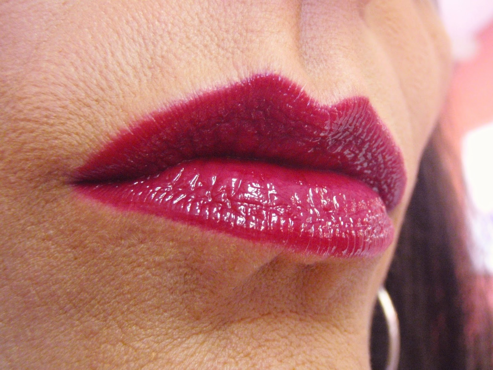 josie maran lipstain with gloss on lips