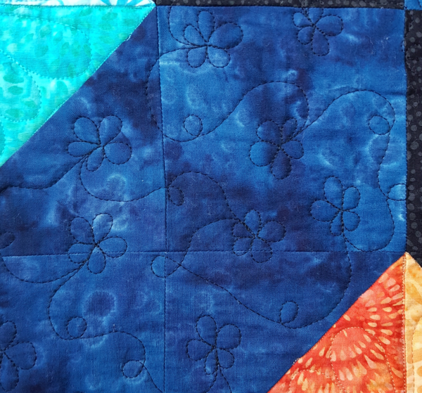 free motion quilting flowers | DevotedQuilter.com