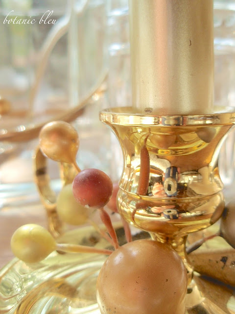 Thanksgiving gold and white table setting with brass candleholder