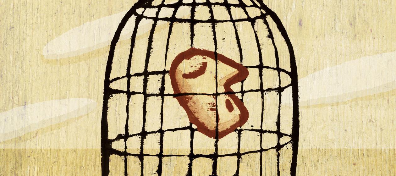 uomo in gabbia