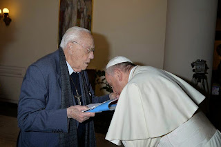 Image result for pope francis kisses hand of priest