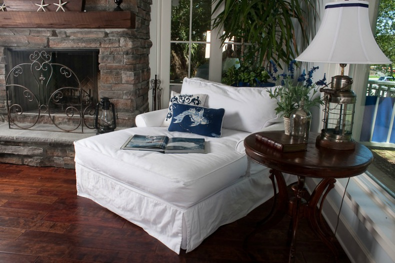 White slipcover chaise in coastal living room from Our Boat House