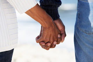 adult couple holding hands