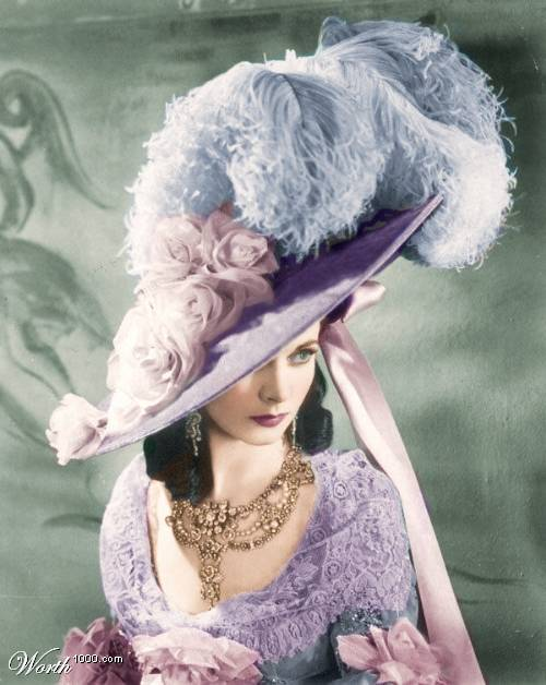 Vivien Leigh in violet with a large feathered hat