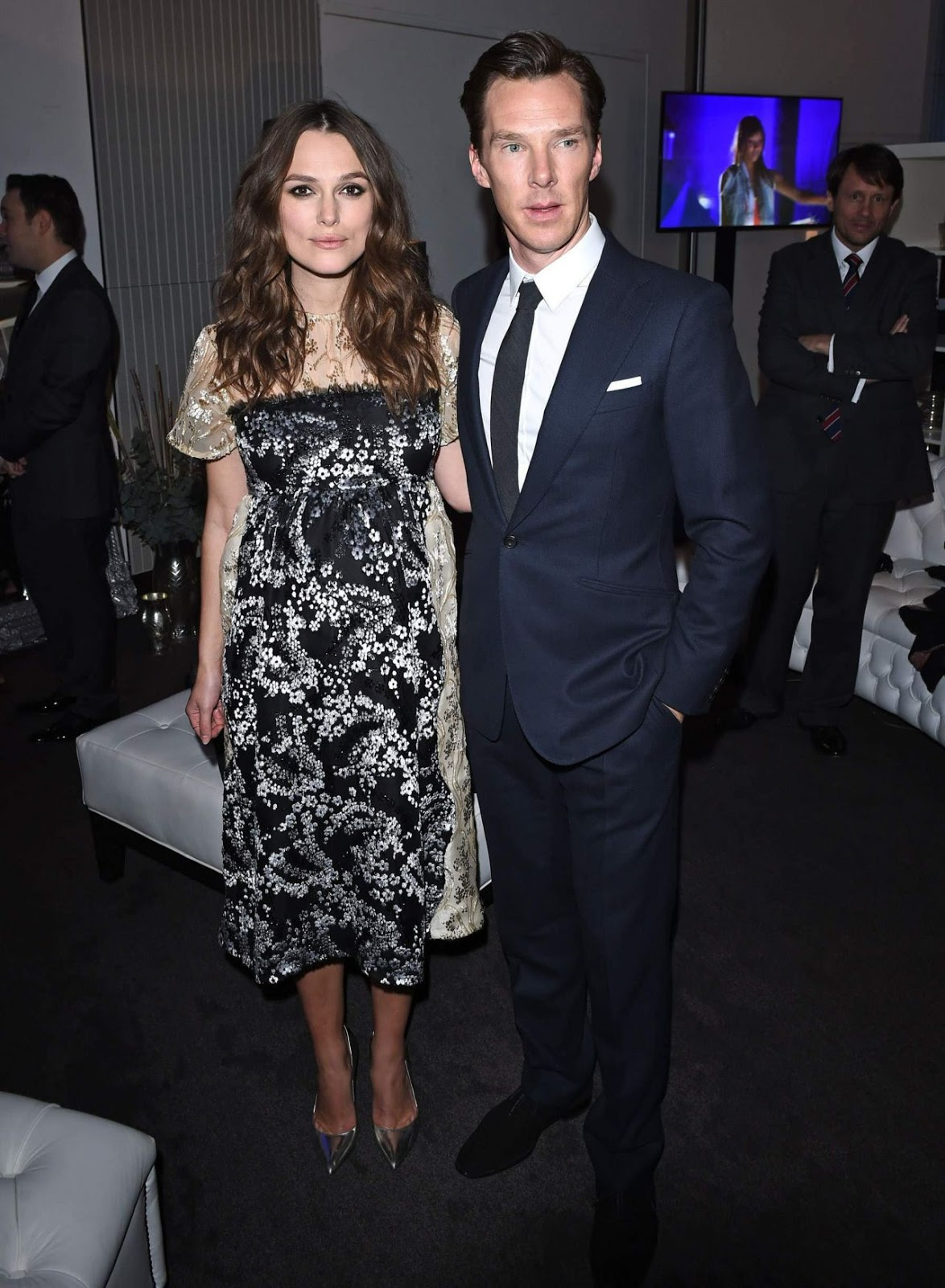 Keira Knightley flaunts baby bump at a pre-BAFTA bash in London