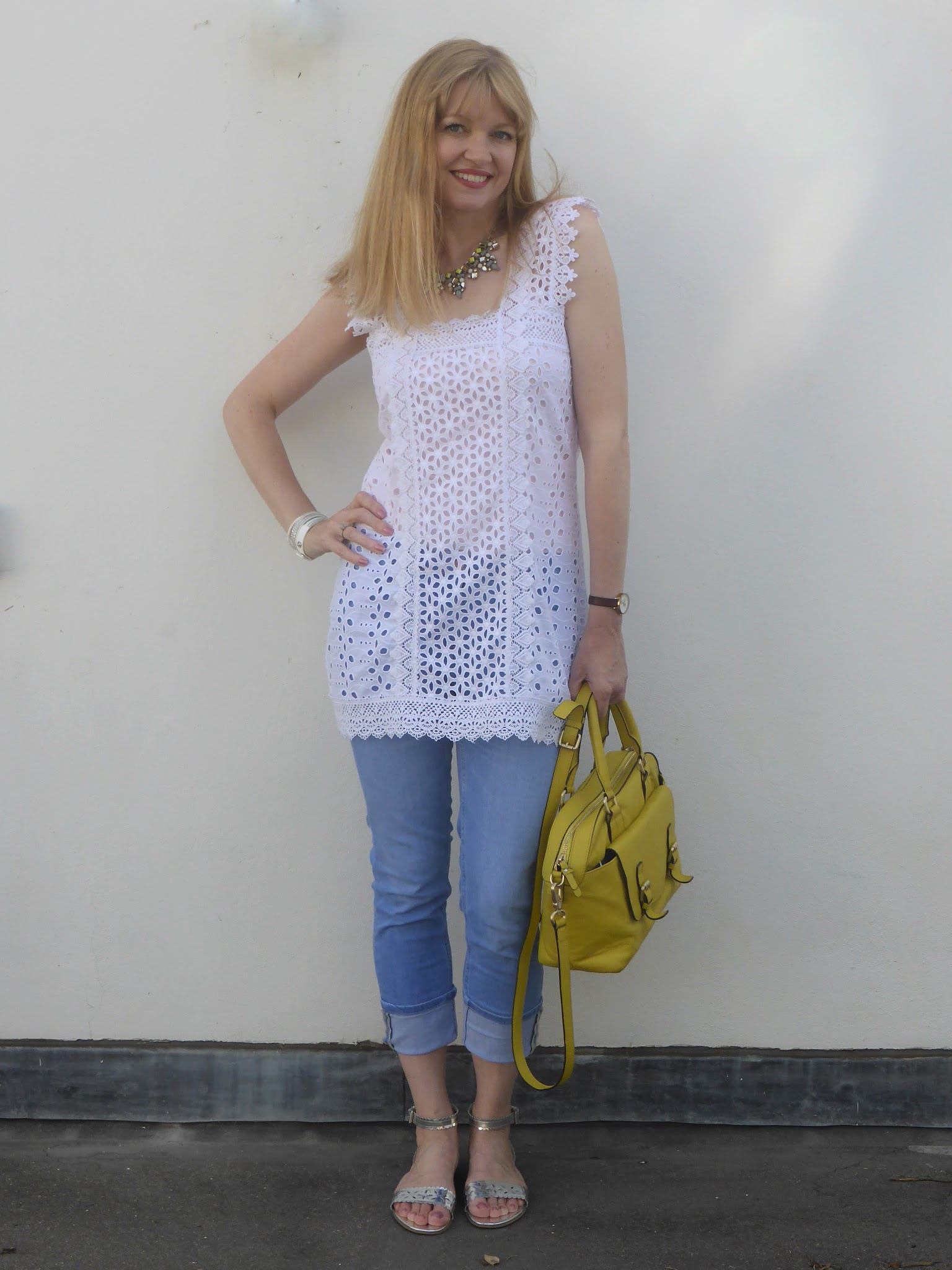 What Lizzy Loves Broderie anglaise tunic and pale cropped jeans