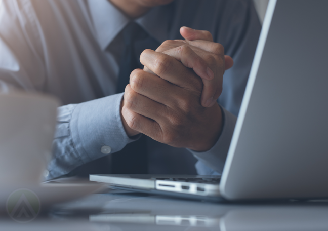 content moderation analyst hands clasping in front of computer