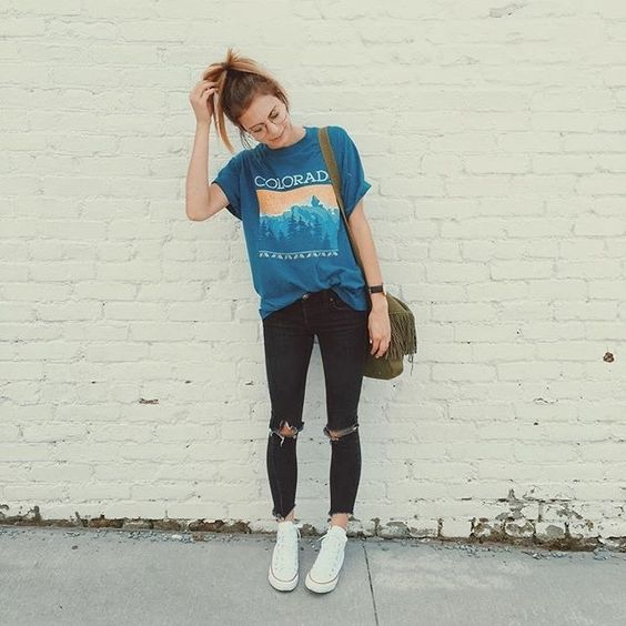 Street Style Blue Graphic T Shirt Distressed Black Jeans White Sneakers And A Handbag