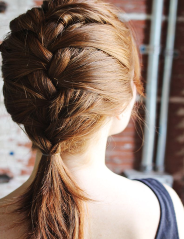 A French braid with a pony tail