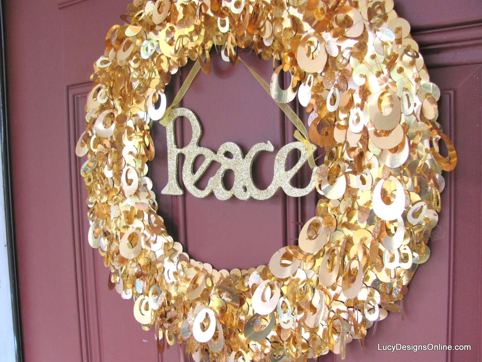 sparkly Christmas wreath with peace sign