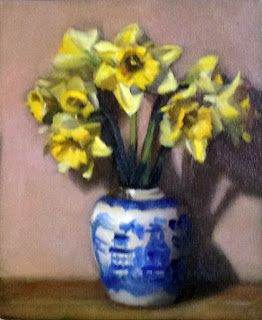 Oil painting of a bunch of yellow daffodils in a blue and white porcelain ginger jar.