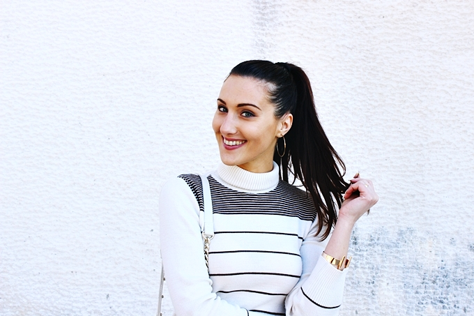 Beige and brown striped turtleneck.Beautiful smile.H&M gold cuff and gold hoop earrings.