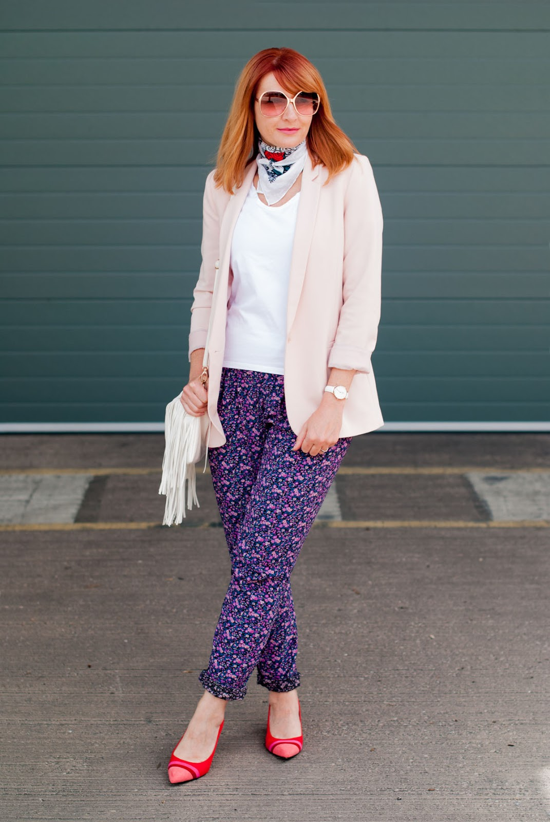 Summer dressing for cooler days: Pale pink blazer  loose floral trousers  red striped block heel shoes  neck scarf  white fringe cross body bag | Not Dressed As Lamb, over 40 style