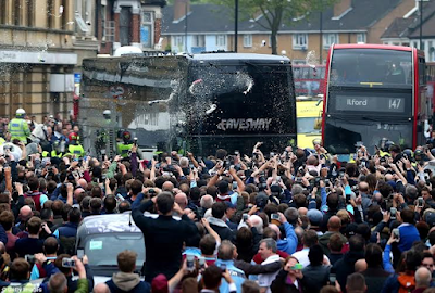 Man U bus attacked by west ham supporters