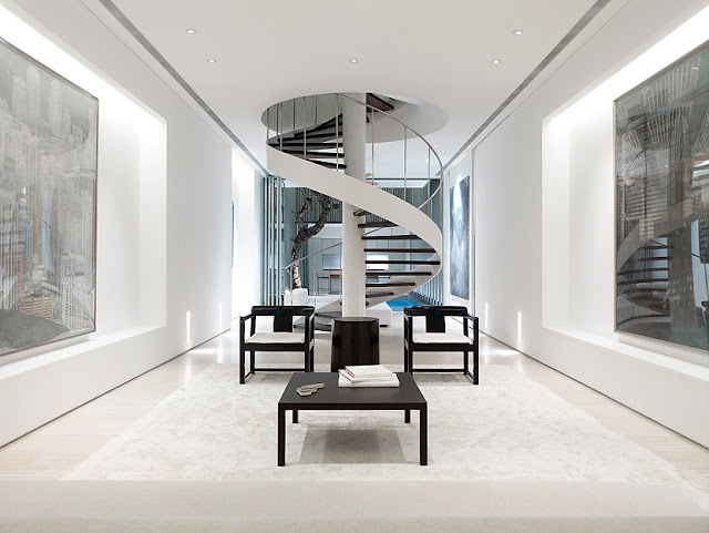 Picture of white narrow interior with spiral staircase