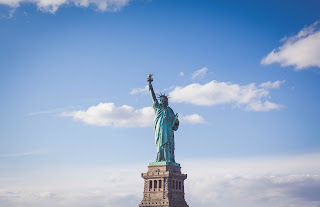The State of Liberty against a blue sky with white clouds
