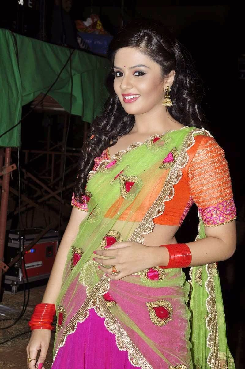 Sri mukhi Stills In Orange Half Saree