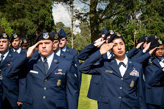 Photo of soldiers saluting.