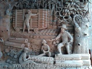 ukiran relief penebangan kayu perhutani