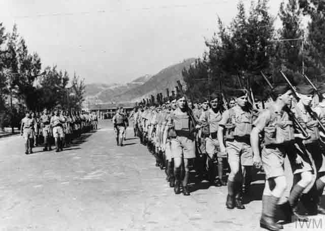 Canadian troops marching into Hong Kong, 16 November 1941 worldwartwo.filminspector.com