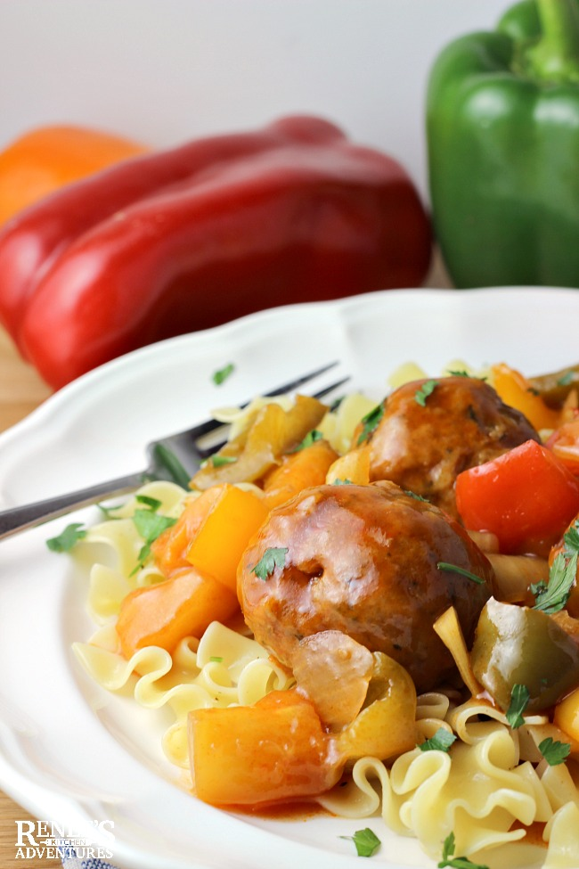 Sweet and Sour Ground Pork Meatballs by Renee's Kitchen Adventures on a white plate with fork and pasta as a complete meal