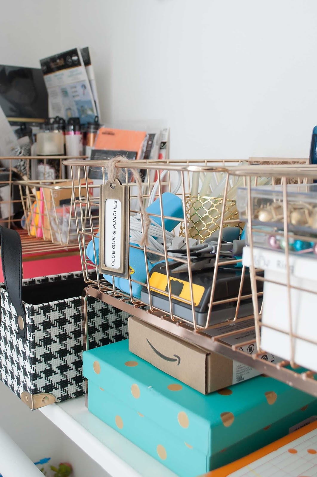 Gold wire baskets and gift tags help organize a home office with craft supplies.