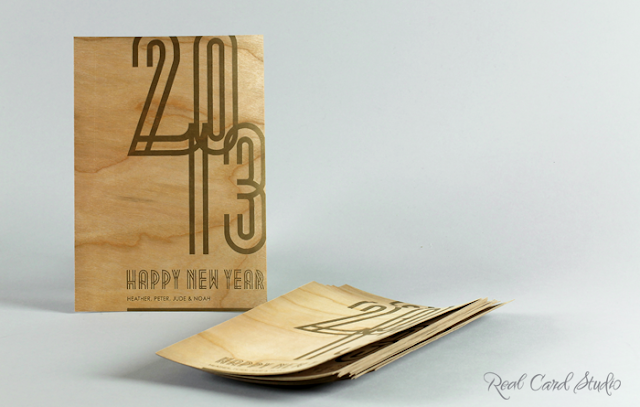 Letterpress printing, happy New Year 2013 holiday card, cherry wood veneer card, art deco typography