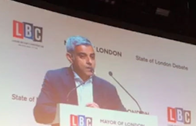 NOT WELCOME!' Shocking moment London Mayor Sadiq Khan is heckled with vile abuse by Tommy Robinson supporters