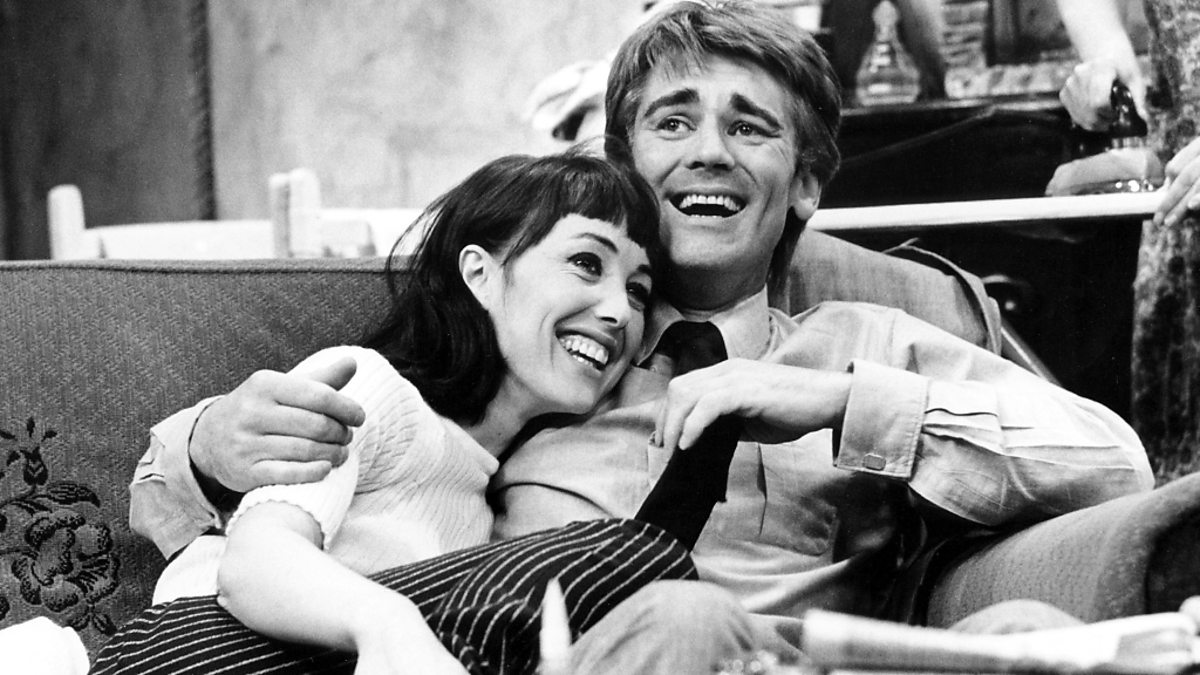 A black and white photograph showing Rita and Mike from Till Death Us Do Part