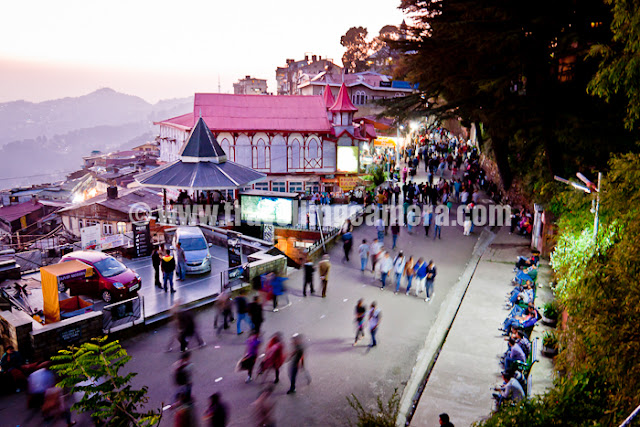 During recent trip to Shimla, I was travelling on bikes most of the time. Our bikes even hit the restricted regions like Mall Road, Ridge and Lakkar bazar... Let's have a quick Photo Journey of Shimla !!!New look of Gaiety Theatre in Shimla. This Theatre is situated on Mall Road and now open for all. There is small ticket amount one needs to pay to explore it inside. Various plays, exhibitions and other cultural events take place at Gaiety Theatre. Some part of Gaiety is also visible from Ridge.Afternoon view of Ridge, Shimla !!! Some Himachal Tourism activity was going and Aneesh was allowed to take his bike to Ridge with proper care. Ridge, Mall Road and Lakkar Bazar regions are restricted areas where vehicles are not allowed.Birds roaming around Ridge/Mall Road during Saturday Evening :) ... Saturday evenings are very popular for folks in Shimla and Mall road is too much crowded during Saturday evenings. Bird watching could be one of the reasons..A view of Shimla from High Court building. This photograph is clicked from Mall Road only, but near High Court of Himachal Pradesh !!!I am completely in love with Shimla Architecture and my camera couldn't resist clicking all those building on Shimla streets & roads. This photograph was clicked while we were climbing up towards Mall Road from HHH hotel.More beautiful buildings from Shimla, but increasing vehicles are becoming one of the main challenges when parking is biggest issue in the city. But it's amazing to these folks driving so fast on narrow roads with lots of curves here and thereHere comes Mr. Aneesh Awasthi. Here he is trying typical short cuts in Shimla, but mostly they are for walking people not for bikers. Since it's difficult for Aneesh to walk, so he thought of riding down these stairs.During noon there is nothing on Mall road so came down towards Shimla Market and thought of going towards Naldera Golf ground... Although plans changed later. I hope you noticed the density of houses on these hills. There is no difference between these hill stations and metros like Delhi now.Here is a view of Mall road after sunset. Folks have started coming to Mall Road and soon it will be fully loaded, or in fact overloaded.Here is another view of Ridge in Shimla. Ridge and Mall road are well connected with each other and have many decent restuarants around the place. Ridge is basically a huge tank of water which is main supply for various parts of Shimla. There is also an underground makrket called Indira Market and Press Club of Shimla is also situated in this market.Wonderful view of Christ Church on Ridge, Shimla. Bright blue sky make this photograph more intersting... This was a qick photo journey with no plans and thought of sharing here... Hope to be there in Shimla for Christmas and wish to click some the same places with snow !!!